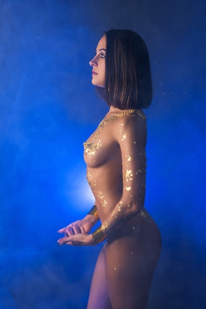 Photo for Nude girl with gold bodyart cropped profile shot - Royalty Free Image
