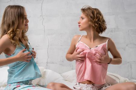 Women in lingerie in bed shot