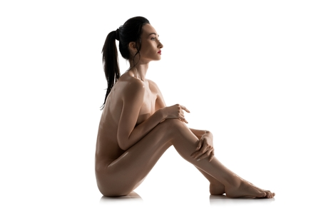 Photo for Nude brunette on the floor isolated profile view - Royalty Free Image