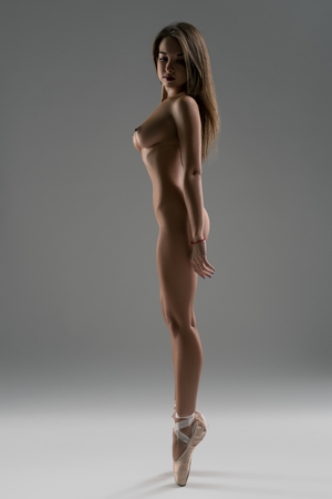 Photo for Woman in the nude on pointe full-length view - Royalty Free Image