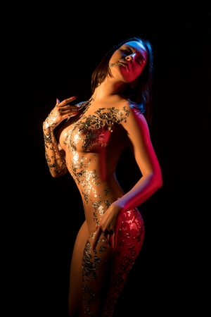 Photo for Nude woman with gold bodyart cropped shot - Royalty Free Image
