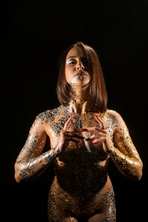 Photo pour Naked girl with gold bodyart cropped shot - image libre de droit