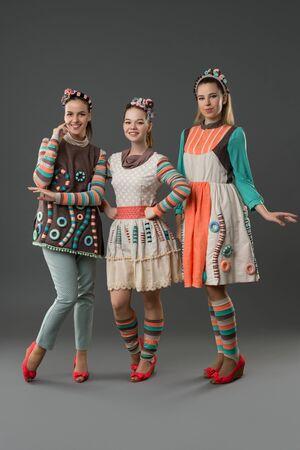 Pretty girls in original folk style dresses view