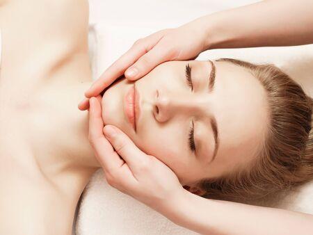 Photo pour Spa. Woman enjoying anti-aging facial massage - image libre de droit