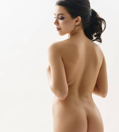 Photo pour Long haired brunette shot naked view from her back - image libre de droit