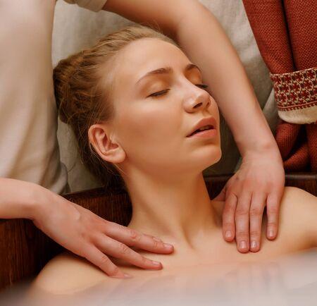 Foto de Girls shoulders massaged during she taking bath - Imagen libre de derechos
