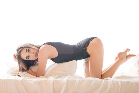 Photo pour Sexy brunette in black body in bed - image libre de droit