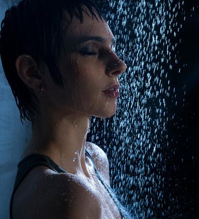 Photo pour Brunette in wet t-shirt under water profile view - image libre de droit
