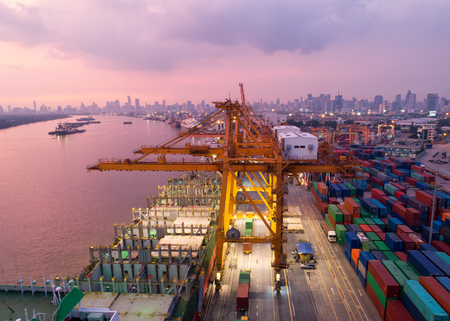 Photo pour Aerial view of a trade port with container ship in import export and business logistic. - image libre de droit