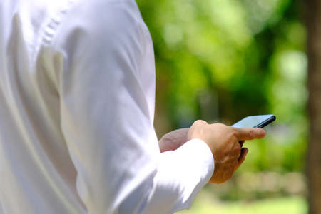 Photo pour businessman using a smartphone and working on technology concept - image libre de droit