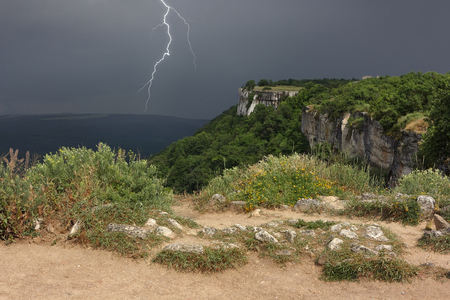 Thunderstorm is an approaching plateau of the Crimean mountains. The dividing line of solar weather and stormy weather in Crimea.