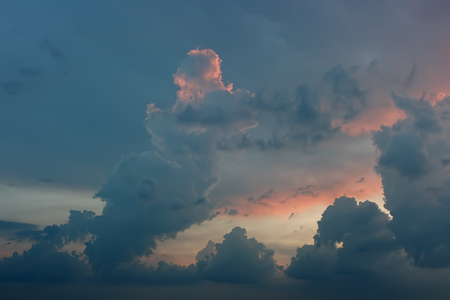 Rainy thundercloud sunset. Sunset in blue-pink tones with thunder clouds.