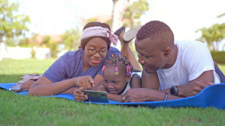Photo for Portrait of an African American family looking very happy outdoors - Royalty Free Image