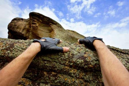hands of rock climbing man