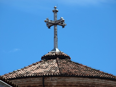 Venice - an old stone cross on the church roof