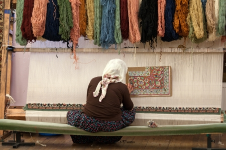 the Turkish woman knitting the silk carpet