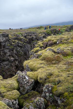 Thingvellir, Iceland - July 19, 2017: People walking in a Fault Line, Thingvellir National Park, Iceland