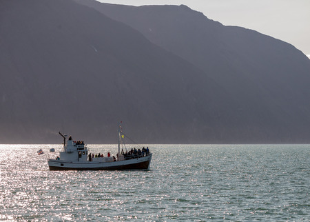 Husavik, Iceland - July 24, 2017: Whale watching boat with passengers going out the Husavik for waching the Humpback Whale. Iceland
