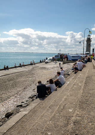 Cancale, France - September 15, 2018: People eating oysters bought on the seafront at Cancale, Brittany, France
