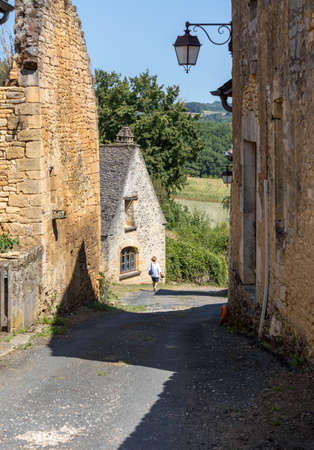 Saint Genies is a lovely; village between Montignac and Sarlat. At the centre of the village is a beautiful ensemble consisting of the church of Notre Dame de l'Assomption and the castle. Perigord; Dordogne; France