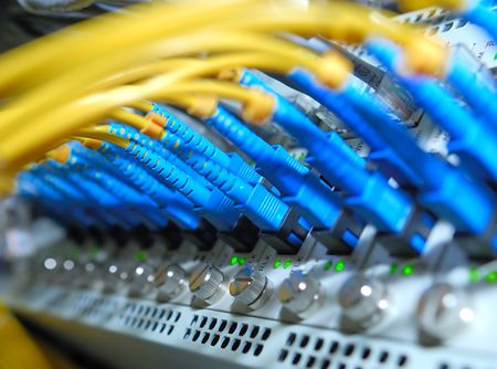 network hub and patch cables,Fiber cables connected to servers in a datacenter(See more network cables and servers backgrounds in my portfolio).