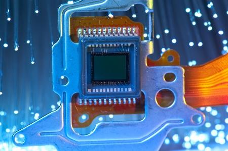 Photo pour CCD sensor on a card of digital camera with fiber optical background  - image libre de droit