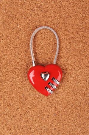 heart shape lock locked up with wood background