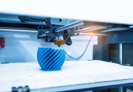 Foto de Modern 3D printer printing figure close-up macro - Imagen libre de derechos