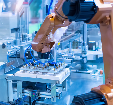 Foto de robotic pneumatic piston sucker unit on industrial machine,automation compressed air factory production - Imagen libre de derechos