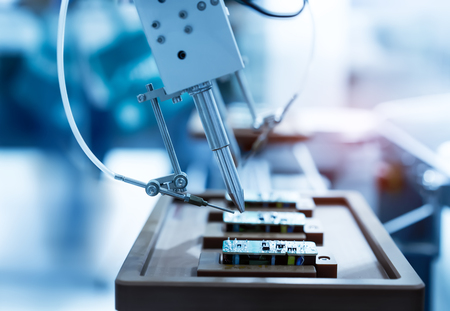 Photo for soldering iron tips of automated manufacturing soldering and assembly pcb board - Royalty Free Image