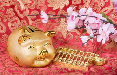 Foto de 2019 is year of the pig,Golden piggy bank with red background,Chinese new year concept, saving concept and wealth. - Imagen libre de derechos