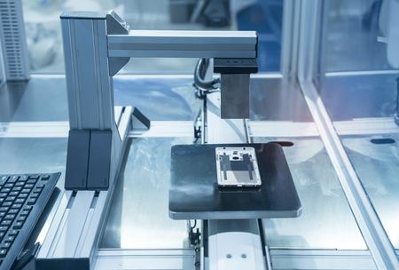 automatic vision sensor machine measure the aluminum mobile phone part .