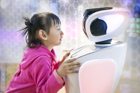 Photo for asian child extends a hand to the robot. concept of friendship between the robot and child - Royalty Free Image