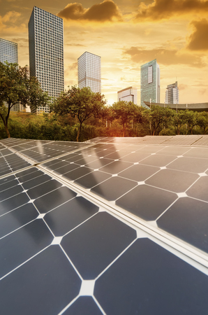 Photo pour Ecological energy renewable solar panel plant with urban landscape landmarks - image libre de droit