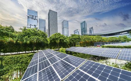 Photo pour solar panels with cityscape of modern city,Ecological energy renewable concept. - image libre de droit