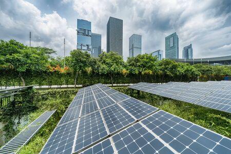 Photo for Ecological energy renewable solar panel plant with urban modern building landscape landmarks - Royalty Free Image