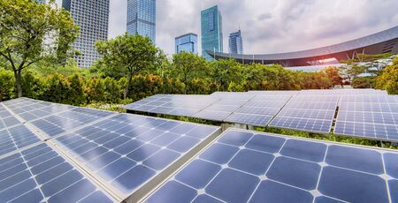 Photo for Ecological energy renewable solar panel plant with urban landscape - Royalty Free Image