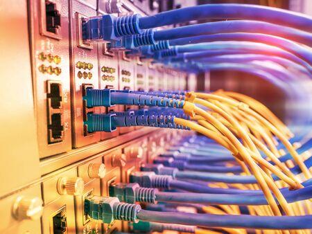 Photo pour Fiber Optic cables connected to an optic ports and Network cables connected to ethernet ports - image libre de droit