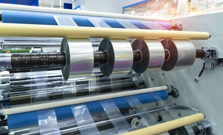 Photo for Laminating and rewinding kind of protective film machine with clamping rollers automatic edge banding - Royalty Free Image