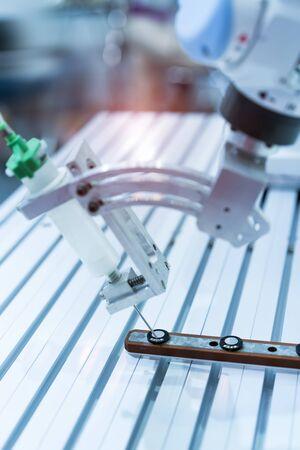 Photo pour Robot holding glue syringe Injection in factory - image libre de droit
