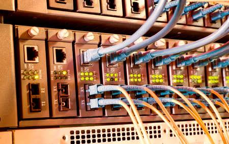 Photo pour Fiber Optic cables connected to an optic ports - image libre de droit