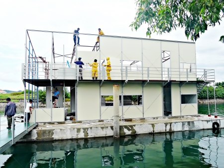 Construction of modular house on top of concrete pontoons