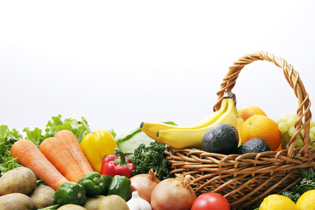Set of different fruits and vegetables on white background