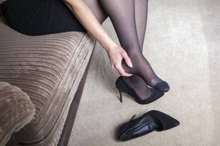 Photo for Tired businesswoman feet pain - Royalty Free Image