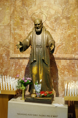 San Giovanni Rotondo, Italy - September 08, 2015: The statue of St. Padre Pio in the Basilica of Our Lady of Grace. Basilica, consecrated in 1959, it was founded near the old monastery of the sixteenth century.
