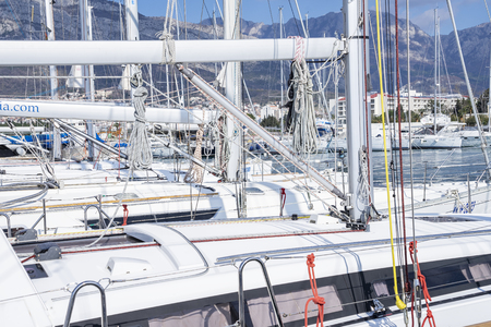 Bar, Montenegro, February 08, 2019: Close-up view from the deck of the yacht to the marina with moored boats and yachts, its masts and folded sails