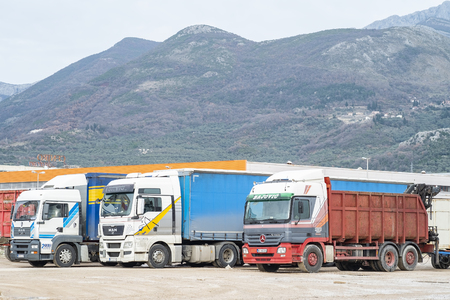 Photo for Bar, Montenegro, February 04, 2019: Trucks are parked in the parking lot at the warehouse in the open air - Royalty Free Image