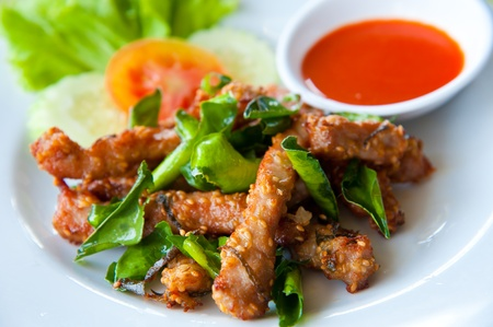 Photo for Deep fried pork with leech lime leaf and chili sauce - Royalty Free Image