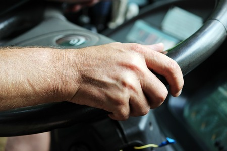 male hands of a large bus driver long haul