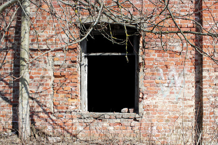 old brick ruins that remained from the historic house. empty window